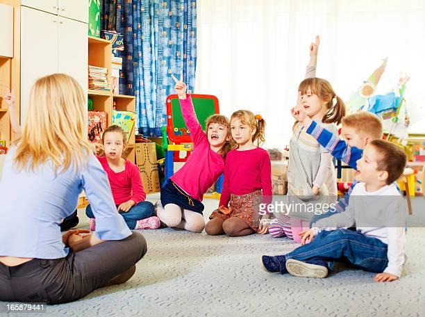 Teacher Questioning Children.