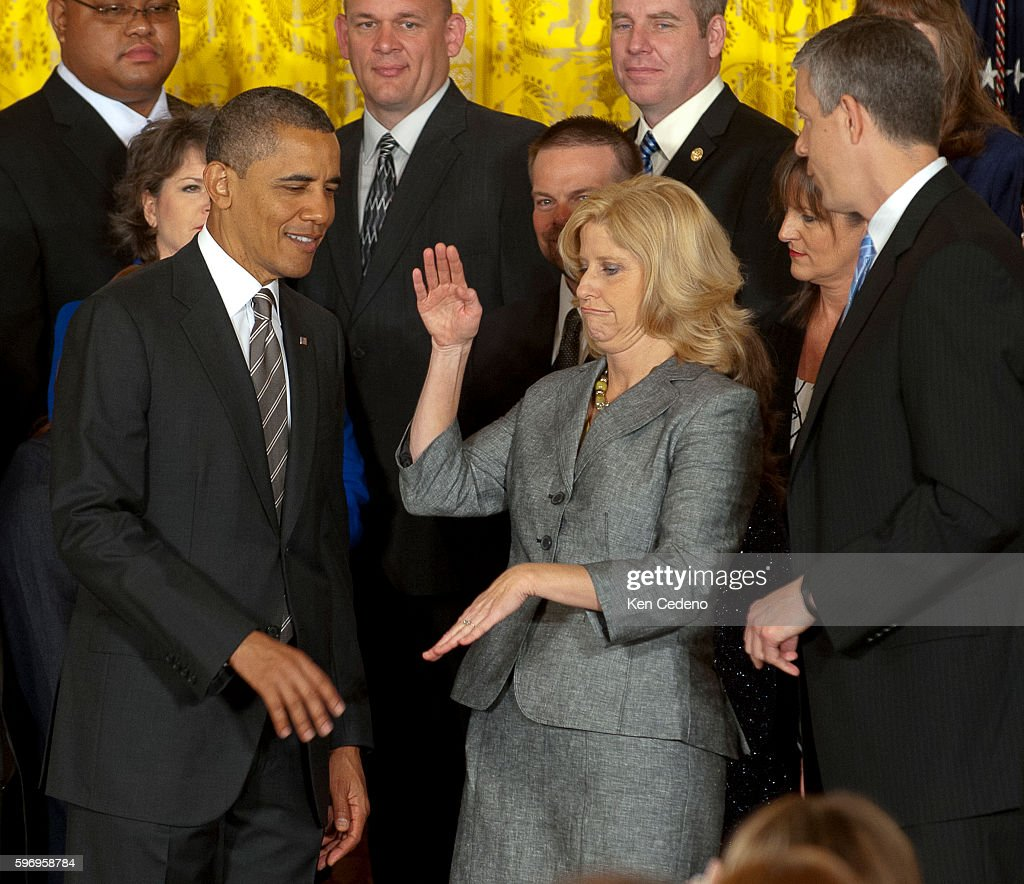 Teacher Rebecca Mieliwocki center caught off guard before her handshake with president Obama Presidnet Obama after she received the 2012 National...