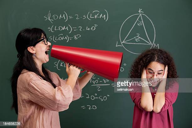Teacher shouting at nerd student for mathmatics