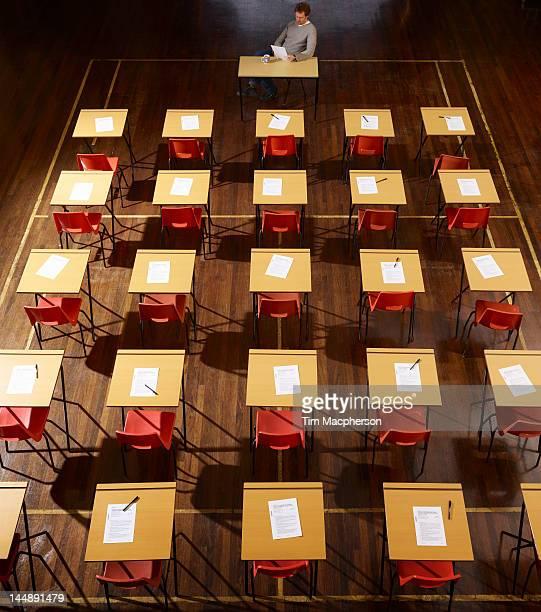 teacher sits in exam hall