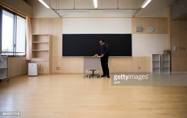 A teacher stands in a classroom as he prepares for the reopening of Narahamachi elementary school in Naraha Fukushima Japan on February 23 2017 The...