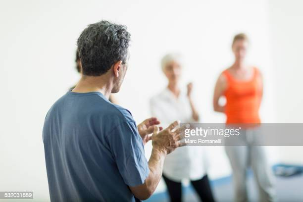 Teacher talking to students in acting class