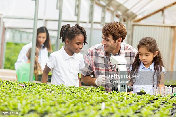 Teacher talks to students about botany during field trip