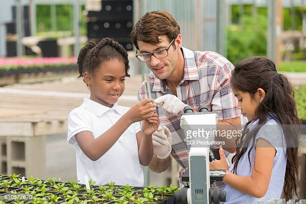 Teacher talks with students about plant life during field trip