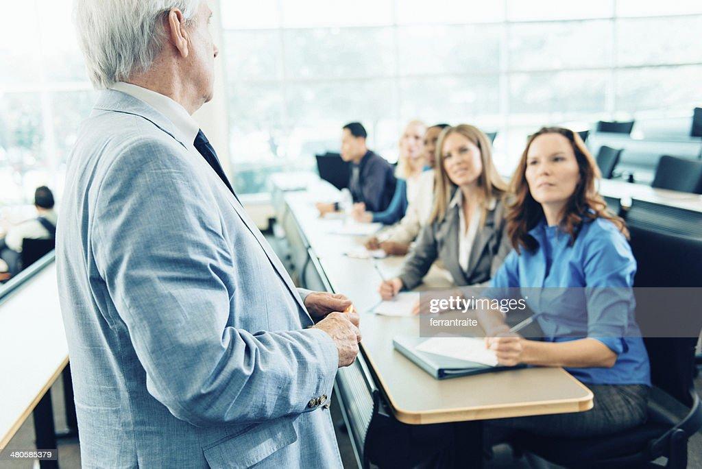 Teacher Teaching Adult Students : Stock Photo