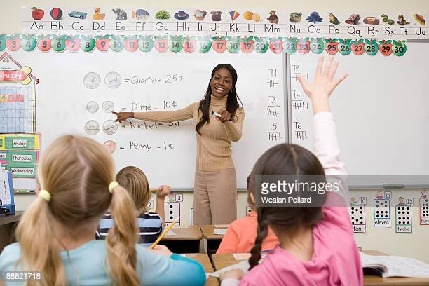 Teacher teaching math to students