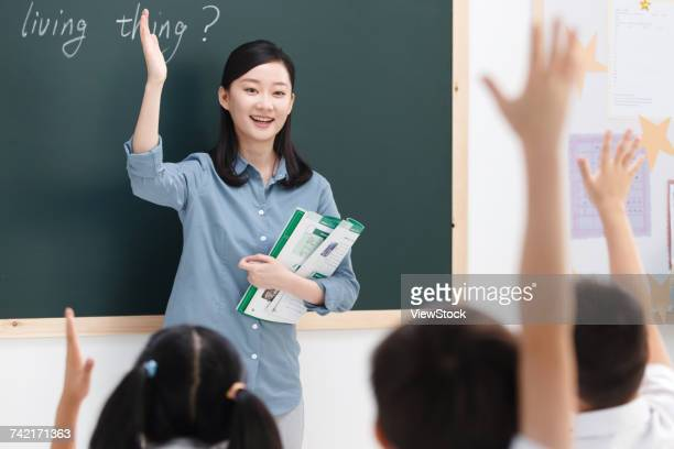 Teacher teaching students in classroom