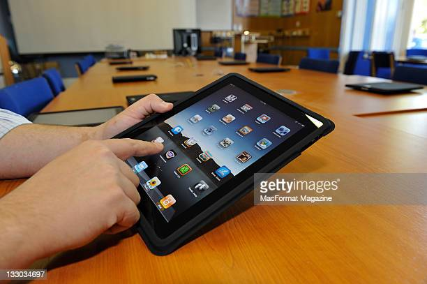 A teacher uses an Apple iPad as a teaching tool in school session for MacFormat Magazine taken on October 5 2010