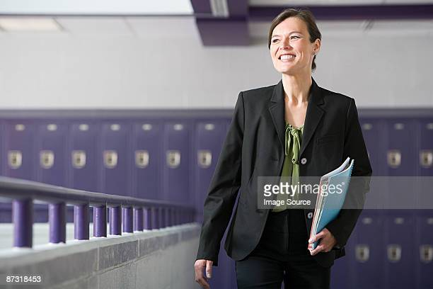 A teacher walking down a corridor