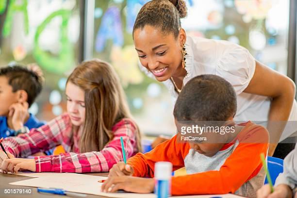 Teacher Watching Students Make Art