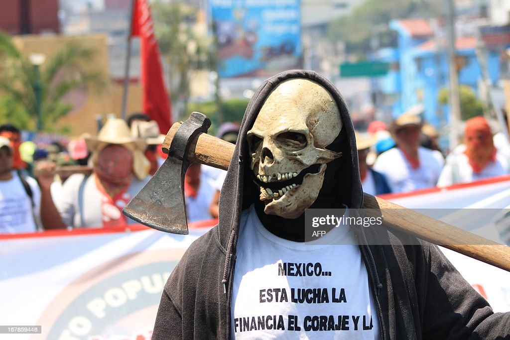 A teacher with a skull mask protests against the education reform during a May Day rally in Chilpancingo, Guerrero state, Mexico on May 1, 2013. AFP PHOTO/Jesus Guerrero