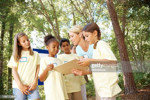 Teacher with her students discussing something from sketch book