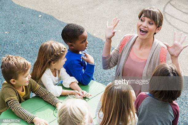 Teacher with preschool children having fun
