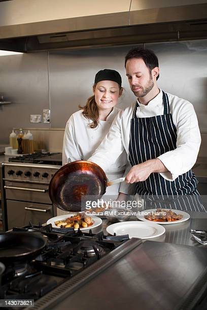 Teacher with student in cooking school
