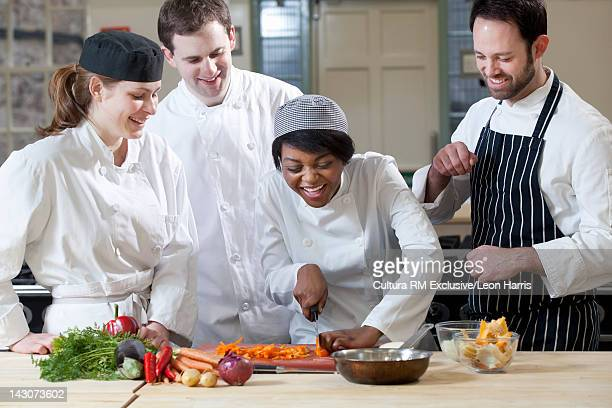 Teacher with students in cooking school
