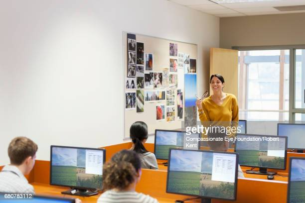 Teacher with teenage students in IT class