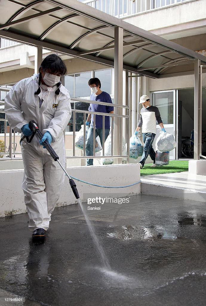 Teachers and parents operate the radioactive decontamination work at Omika Elementary School, which resume classes in October, on October 2, 2011 in Minamisoma, Fukushima, Japan. The Japanese government released the evacuation advisory for the Emergency Evacuation Preparation Zone within 20-30km from the troubled Fukushima Daiichi Nuclear Power Plant on September 30, though higher radioactive substance have been detected in the area.
