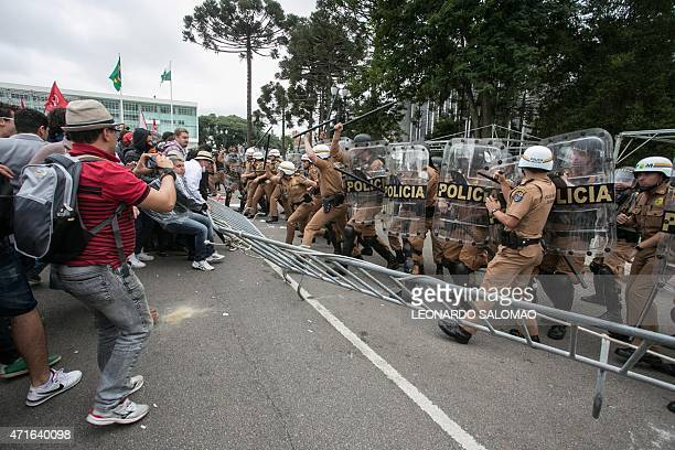 Teachers and PM militarized police in riot gear clash in downtown Curitiba Brazil on April 29 2015 during protests of teachers for better wages and...