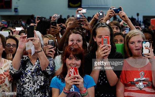Teachers and students listen to US President Barack Obama at Mooresville Middle School in Mooresville North Carolina on June 6 2013 Obama arrived in...