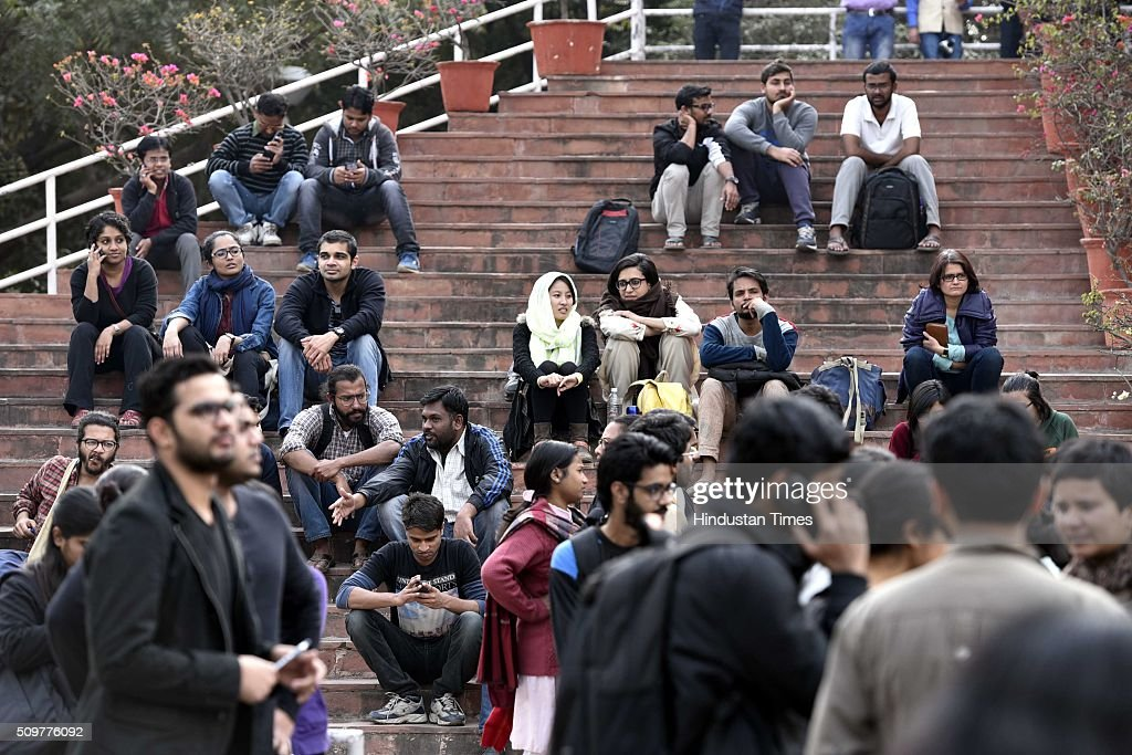 JNU teachers and students protest inside JNU Campus against arrest of JNU students union president Kanhaiya Kumar on February 12, 2016 in New Delhi, India. JNU students union president Kanhaiya Kumar was arrested on in connection with a case of sedition and criminal conspiracy over holding of an event at the prestigious institute against hanging of Parliament attack convict Afzal Guru in 2013. A group of students on Tuesday held an event on the JNU campus and allegedly shouted slogans against India.