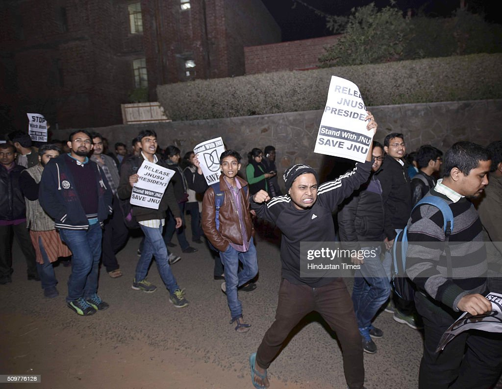 JNU teachers and students protest march inside JNU Campus against arrest of JNU students union president Kanhaiya Kumar on February 12, 2016 in New Delhi, India. JNU students union president Kanhaiya Kumar was arrested on in connection with a case of sedition and criminal conspiracy over holding of an event at the prestigious institute against hanging of Parliament attack convict Afzal Guru in 2013. A group of students on Tuesday held an event on the JNU campus and allegedly shouted slogans against India.