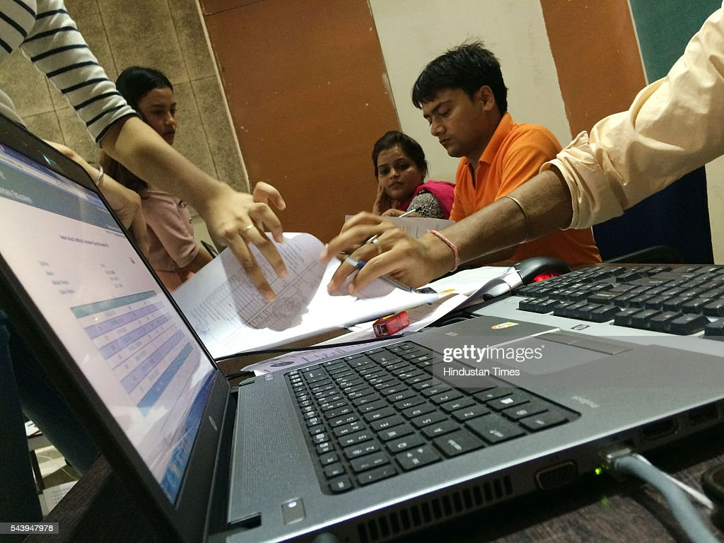 Teachers check the documents of students, completing their admission formalities at Venkateshwar college on June 30, 2016 in New Delhi, India. Delhi University came out with its first cut off list on June 29, 2016.