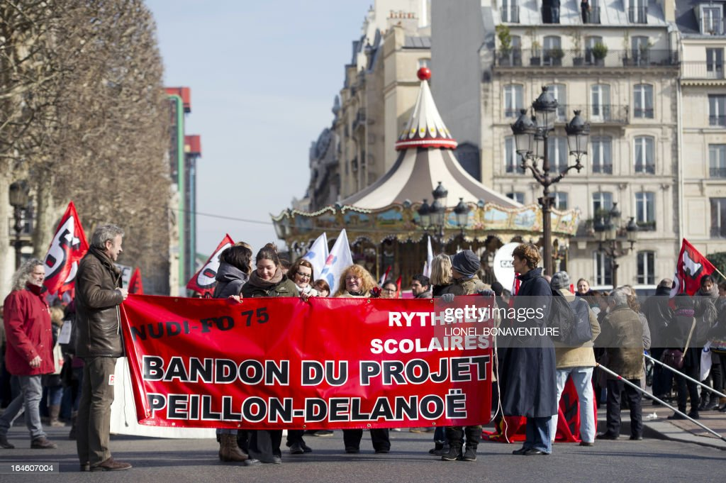 Teachers demonstrate in front of Paris' city hall, on March 25, 2013, as Paris' municipal council gathers to vote the application for the 2013-2014 schoolyear of a reform law increasing the class time of primary school students.