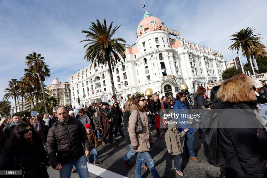 Teachers demonstrate, on February 12, 2013 on the famous 'Promende des Anglais' Nice, southeastern France, as part of a nationwide strike day over the government's plans to make children attend classes five days a week, instead of the current four. The government recently issued a decree introducing a half day of school on Wednesdays for children 3 to 11 starting in September, while reducing the school day by 45 minutes the rest of the week. AFP PHOTO / VALERY HACHE