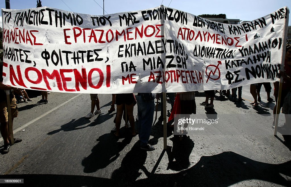 Teachers hold banners during protests against austerity and job cuts on September 18, 2013 in Athens, Greece. As part of the redeployment plan in the country reeling from six years of recession, civil servants have to accept new posts or spend eight months on reduced salaries as alternative posts are found, with the risk of losing their jobs altogether.