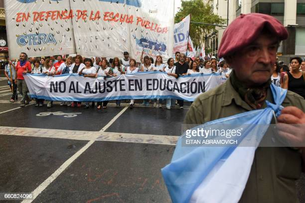 Teachers march toward the Plaza de Mayo square during a demonstration called by the Argentine Central Workers union against President Mauricio Macri...