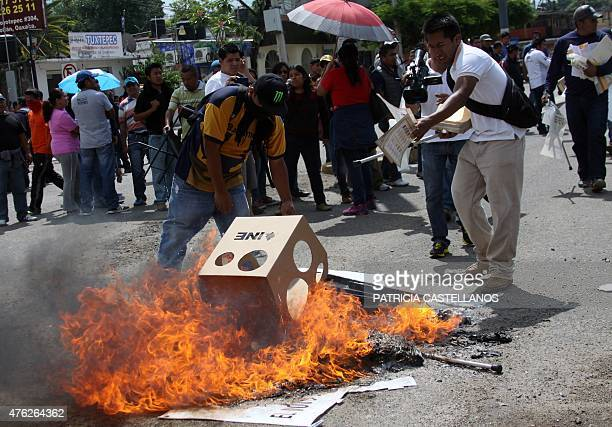 Teachers of the National Union of Education Workers burn electoral material on June 7 2015 during legislative and local elections in Oaxaca Mexico...