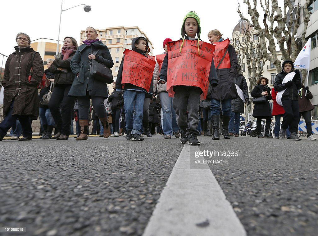 Teachers, parents and children demonstrate, on February 12, 2013 in Nice, French Riviera, as part of a nationwide strike day over the government's plans to make children attend classes five days a week, instead of the current four. The government recently issued a decree introducing a half day of school on Wednesdays for children 3 to 11 starting in September, while reducing the school day by 45 minutes the rest of the week.
