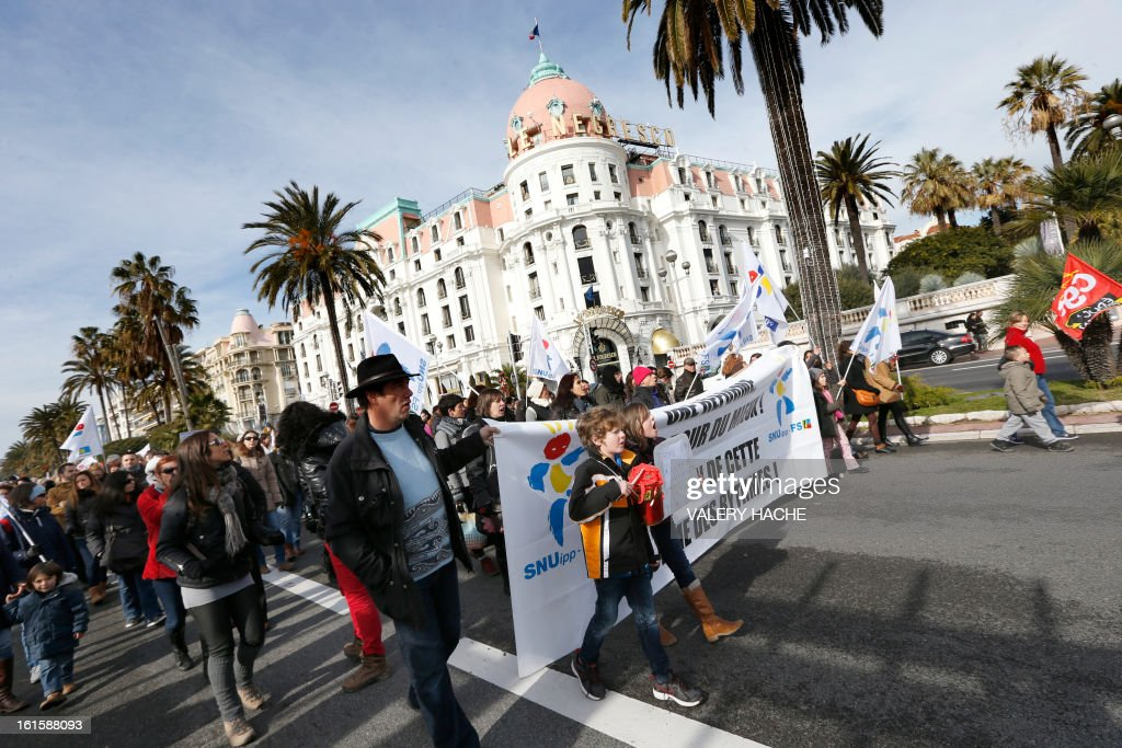 Teachers, parents and children demonstrate on the famous 'Promenade des Anglais', on February 12, 2013 in Nice, French Riviera, as part of a nationwide strike day over the government's plans to make children attend classes five days a week, instead of the current four. The government recently issued a decree introducing a half day of school on Wednesdays for children 3 to 11 starting in September, while reducing the school day by 45 minutes the rest of the week.