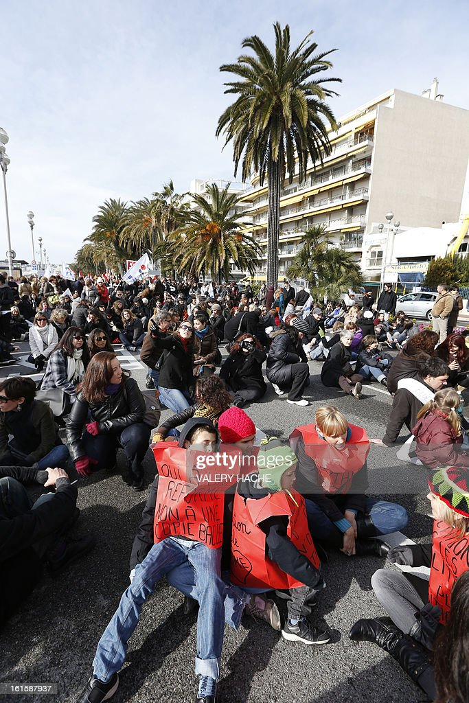 Teachers, parents and children made a sit-in as they demonstrate, on February 12, 2013 in Nice, French Riviera, as part of a nationwide strike day over the government's plans to make children attend classes five days a week, instead of the current four. The government recently issued a decree introducing a half day of school on Wednesdays for children 3 to 11 starting in September, while reducing the school day by 45 minutes the rest of the week.