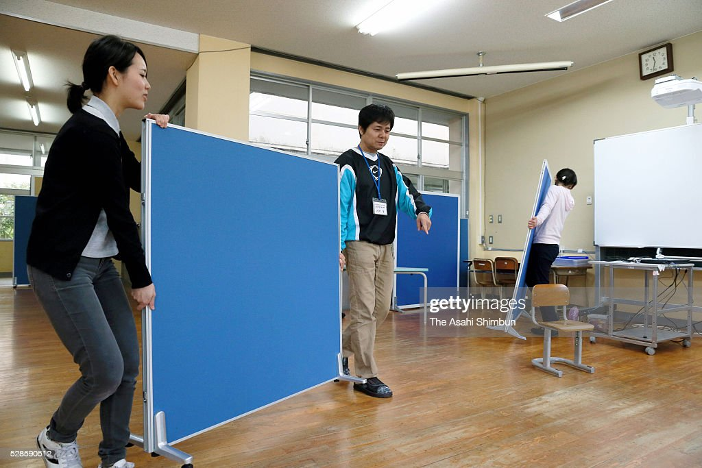 Teachers prepare for school restart next Monday, relocating stuffs from classrooms which had been used as an shelter for evacuees on May 6, 2016 in Minamiaso, Kumamoto, Japan.