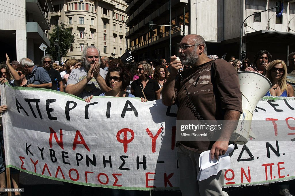Teachers protest with banners during a demonstration against austerity and job cuts on September 18, 2013 in Athens, Greece. As part of the redeployment plan in the country reeling from six years of recession, civil servants have to accept new posts or spend eight months on reduced salaries as alternative posts are found, with the risk of losing their jobs altogether.