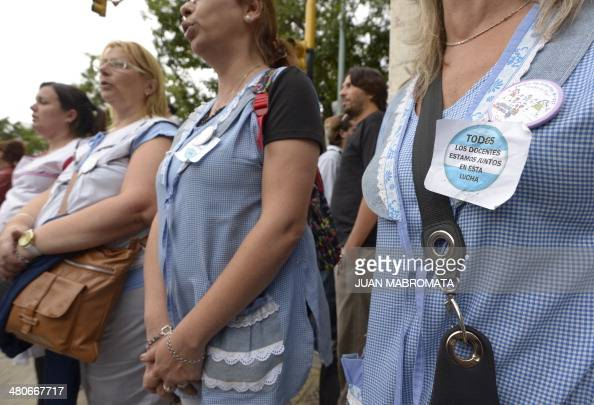 Teachers sing Argentina's national anthem during a demonstration demanding a pay rise in front of the Education Ministry in Buenos Aires on March 26...
