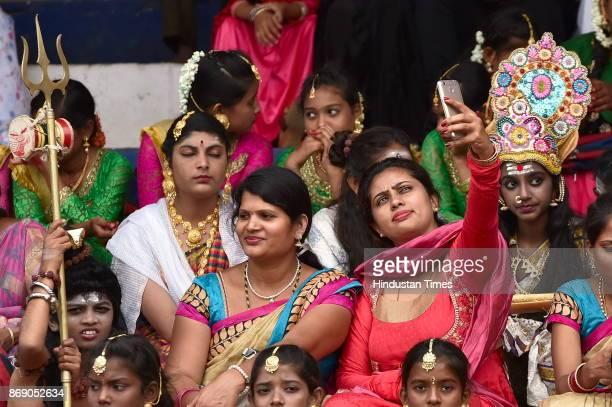 Teachers taking selfie with students during Karnataka Rajyotsava celebration at Kranteerava stadium on November 1 2017 in Bengaluru India All the...