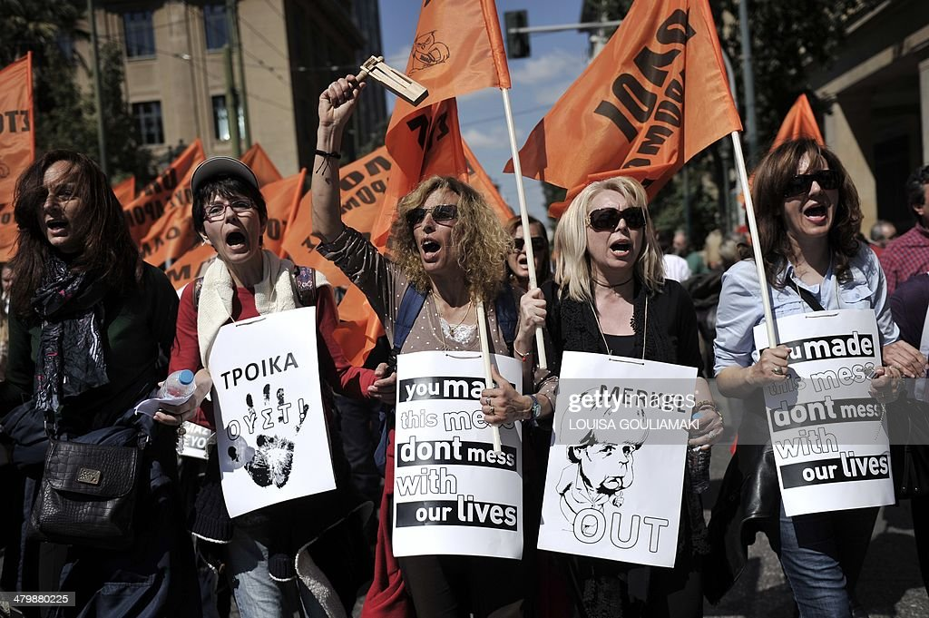 Teachers, who are on a mobility scheme for eight months and face layoffs as of tomorrow, stage a protest in central Athens on March 21, 2014 against planned job cuts in their sector demanded by foreign lenders. .Hard hit by the economic crisis, Greece is experiencing a sixth straight year of recession and has a staggering 28 percent unemployment rate.