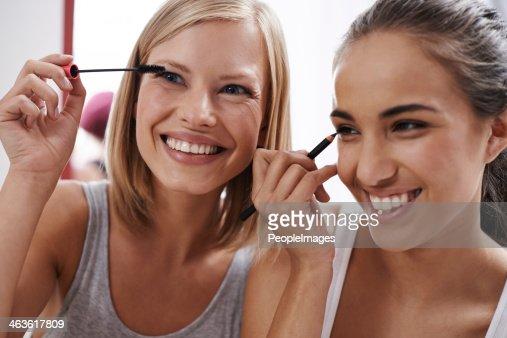 Teaching each other makeup tricks