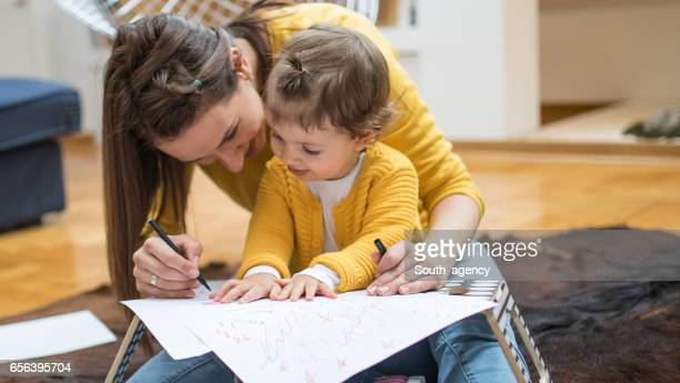 Teaching her daughter to draw