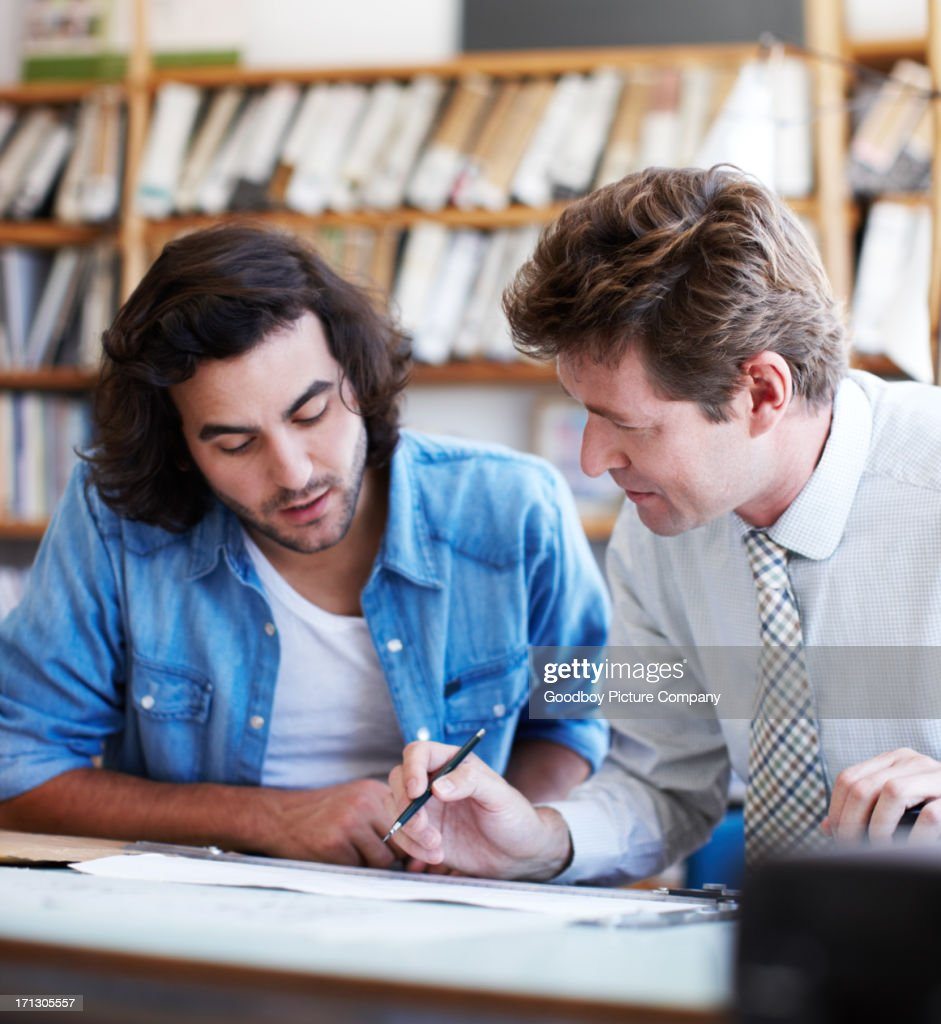 Teaching his protege all the finer points : Stock Photo