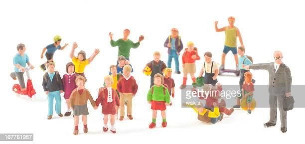Enseigner-Professeur avec les élèves abstrait figurines à l'école