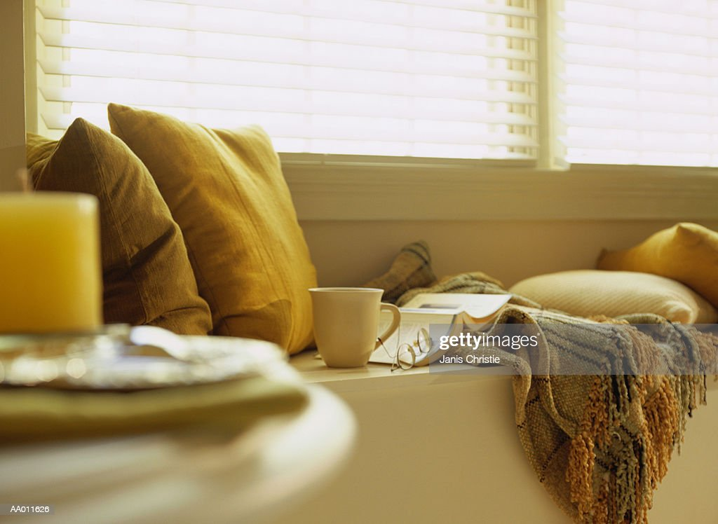 Teacup and a Book on a Window Seat