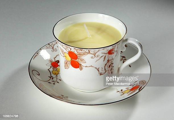 A teacup containing a candle is displayed at The Wellcome Collection's 'Things' Exhibition on October 16 2010 in London England Members of the public...