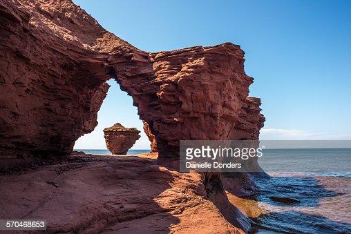 Teacup rock formation through sandstone arch