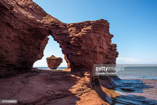 Teacup rock formation through sandstone arch