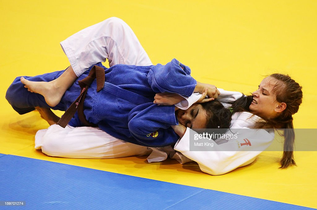 Teagan Kimeklis of Australia competes against Sabrina Araujo of Brazil in the Women's 52kg Judo during day four of the Australian Youth Olympic...