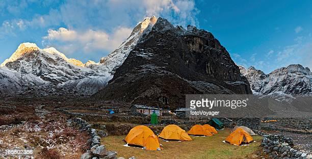 Teahouse camp under Himalaya mountain peaks panorama sunrise