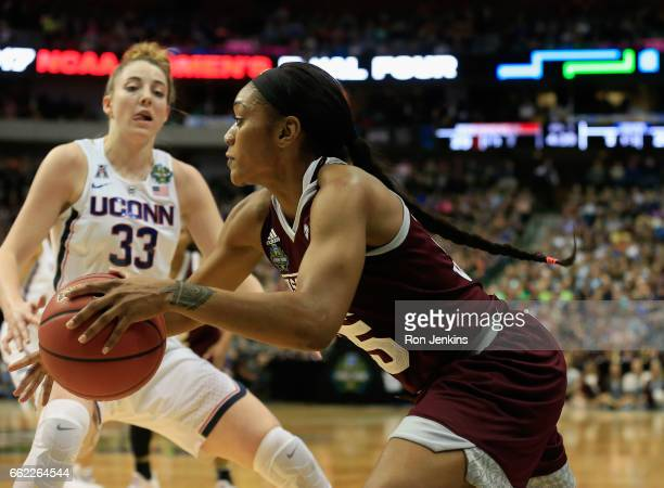 Teaira McCowan of the Mississippi State Lady Bulldogs drives against Katie Lou Samuelson of the Connecticut Huskies in the first half during the...